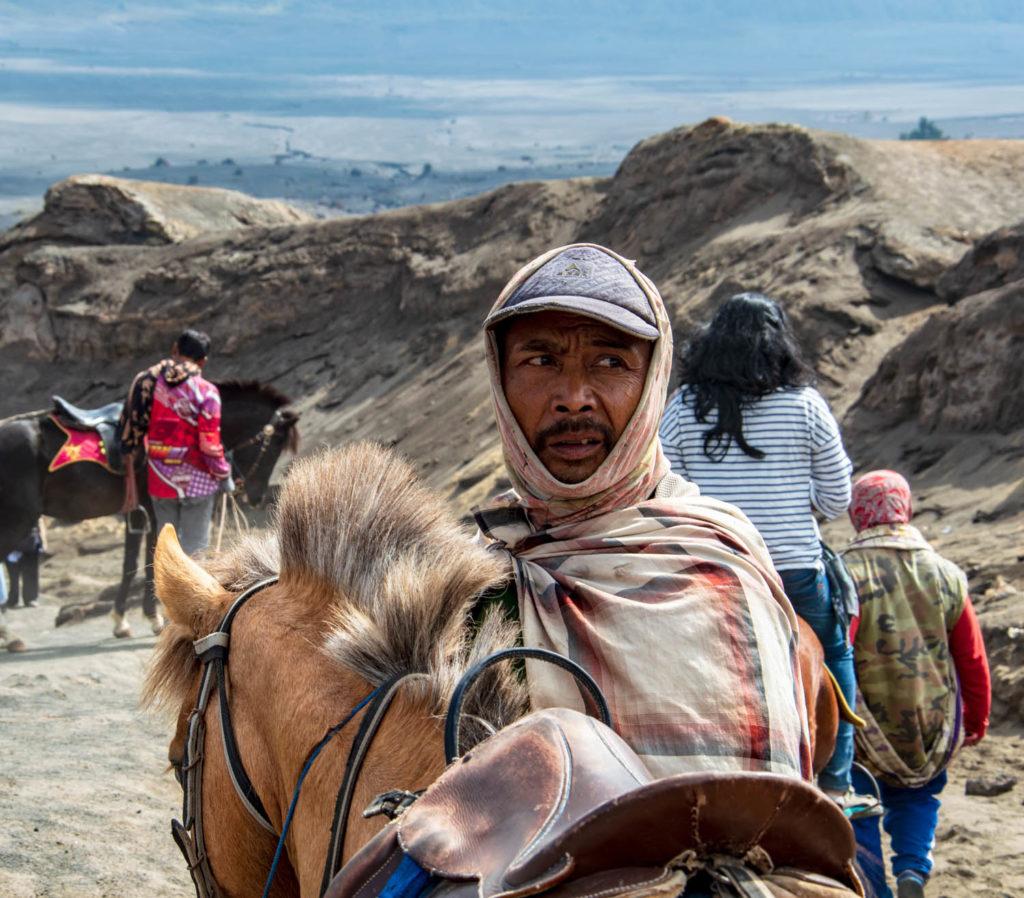 mount bromo indonesia locals with horse