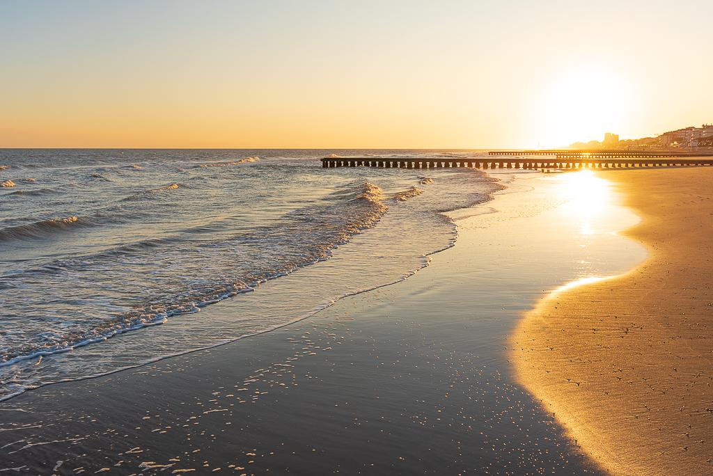 sea shore waves sunrise golden light Jesolo Italy travel landscape photo Marina Chirico photography